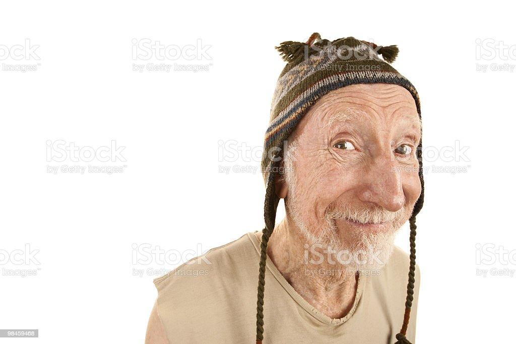 Sorridente uomo anziano in berretto in maglia foto stock royalty-free