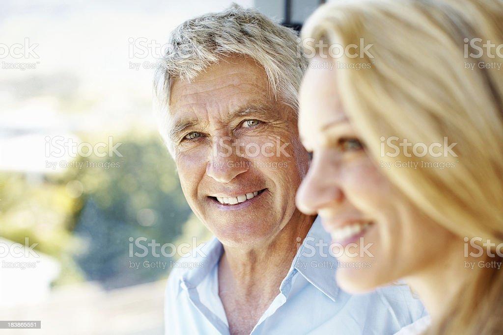 Smiling, senior man looking at a woman royalty-free stock photo