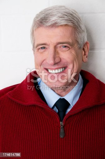 istock smiling senior man 174614786