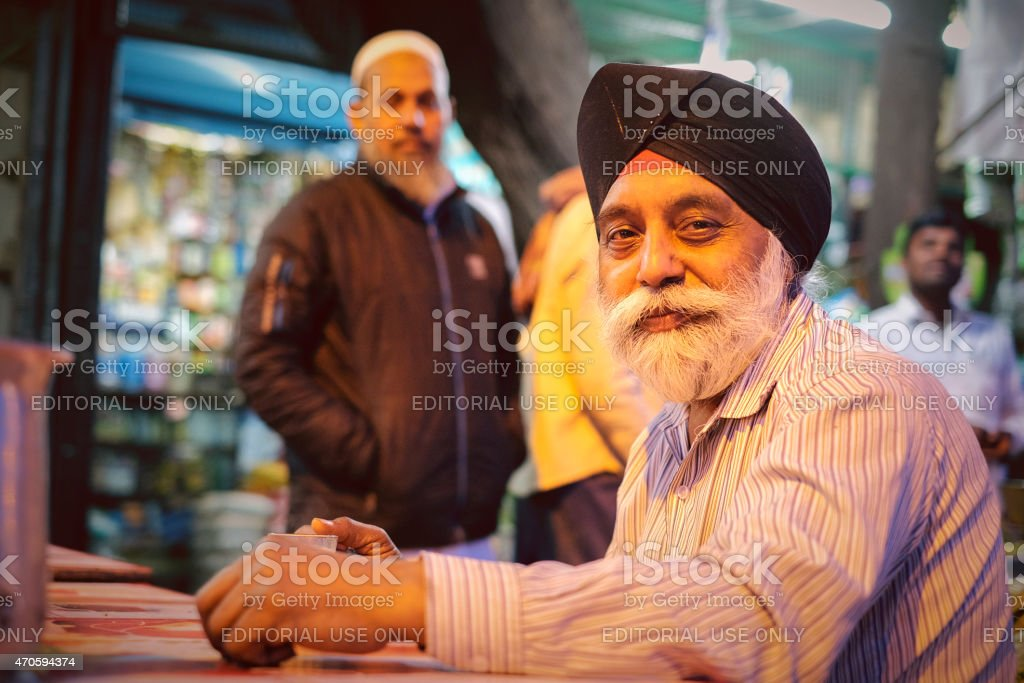 Smiling Senior Sikh Man in New Delhi at Evening stock photo