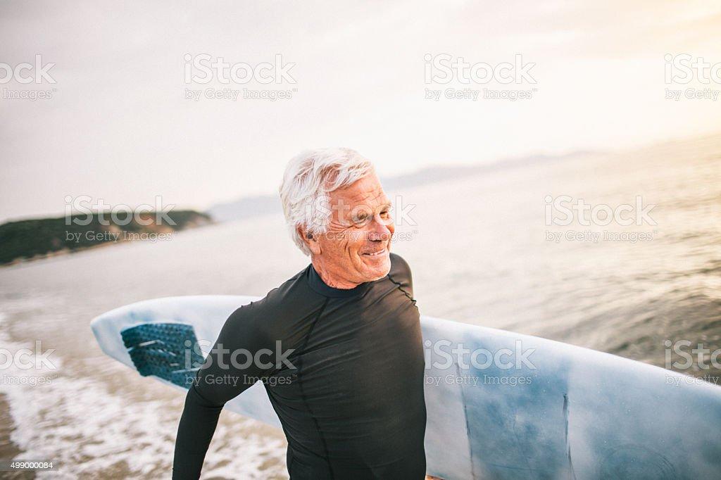 Smiling senior surfer royalty-free stock photo