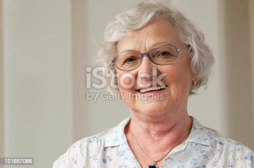 istock Smiling senior woman closeup 121687086