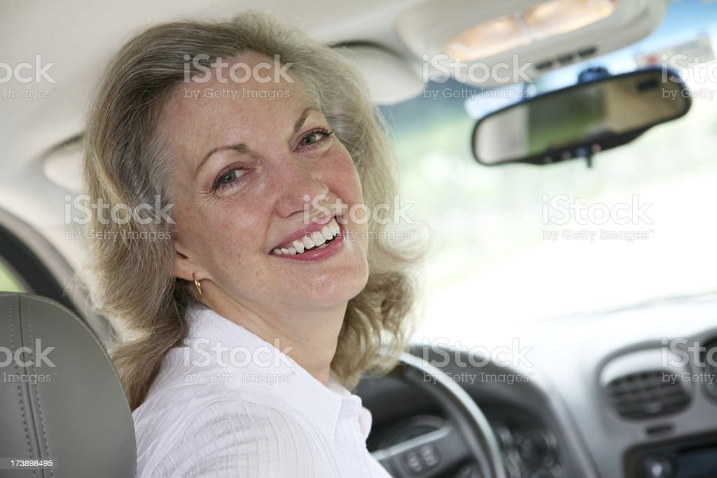 Smiling Senior Woman Inside Her Car royalty-free stock photo