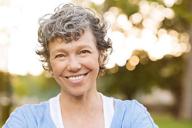 smiling senior woman - adults only stock photos and pictures