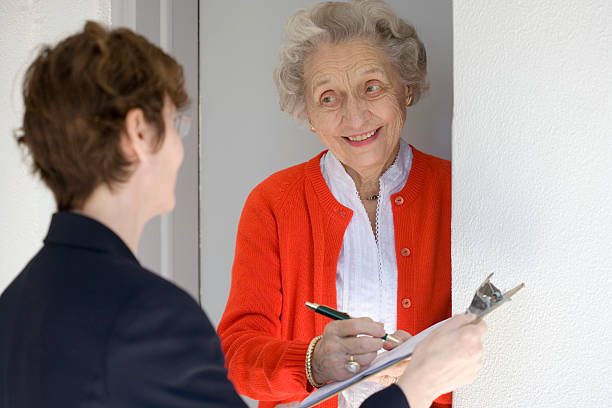 Smiling senior woman signing petetion stock photo