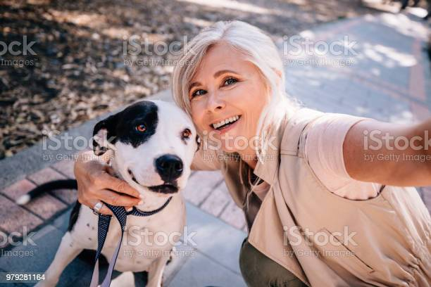 Smiling senior woman taking selfies with pet dog in park picture id979281164?b=1&k=6&m=979281164&s=612x612&h=n2cxlepwtrokwapn4jyzufk4jnzgc2rfhntbm8y7oyg=