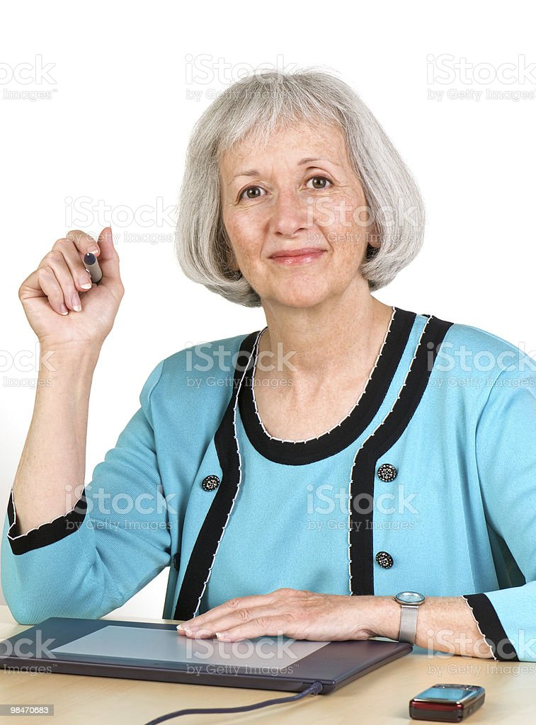 Smiling Senior Woman With Graphics Tablet royalty-free stock photo