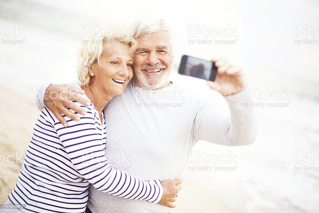 Smiling seniors taking photos royalty-free stock photo