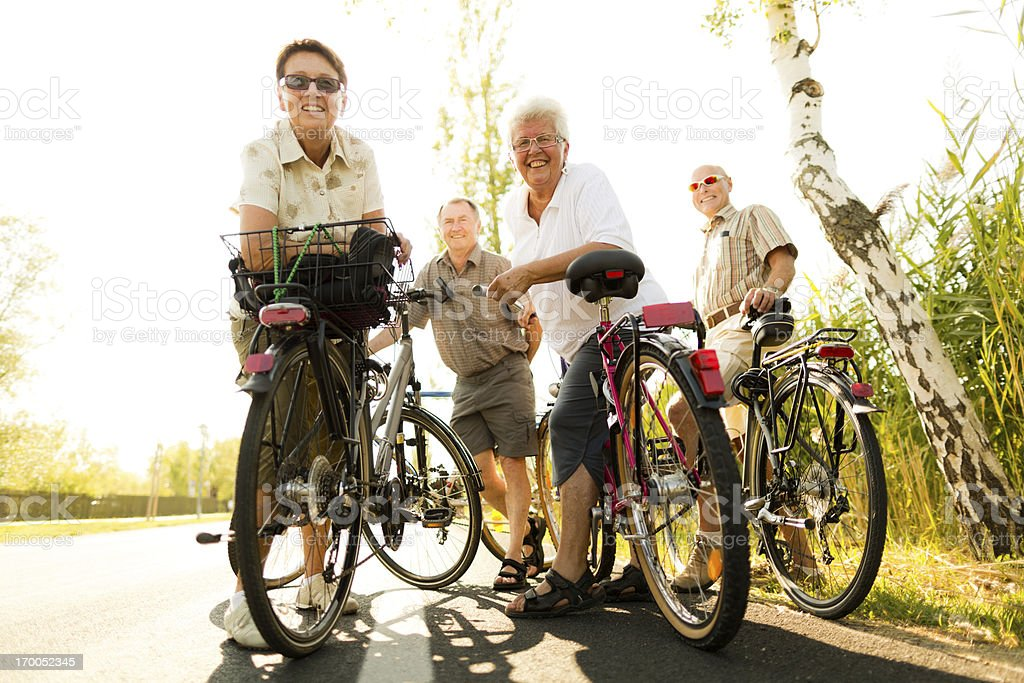 smiling seniors with bicycles stock photo