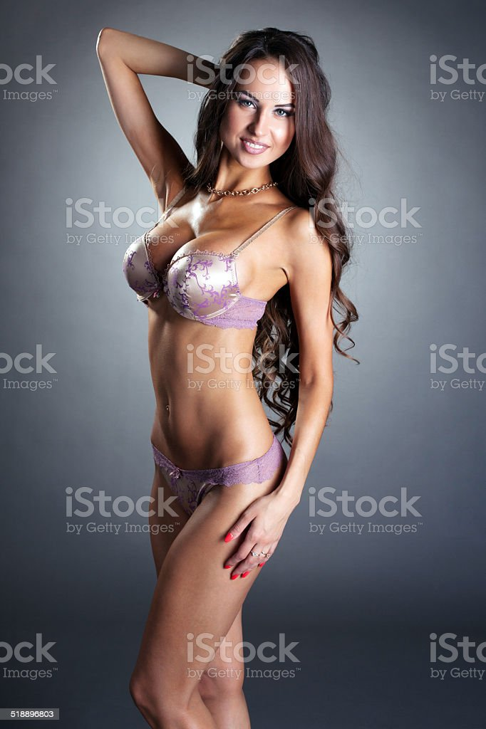 b55543300 Smiling Sexy Underwear Model Posing At Camera Stock Photo   More ...