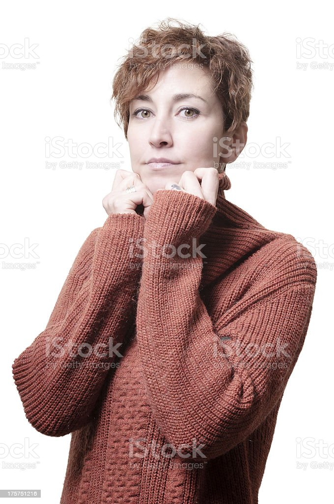 smiling short hair girl cold with orange sweater stock photo