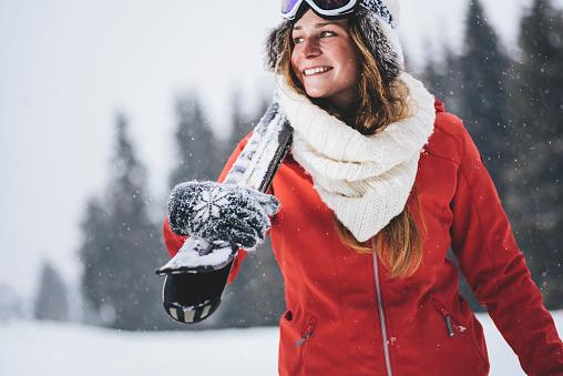 Smiling skier enjoying the winter time
