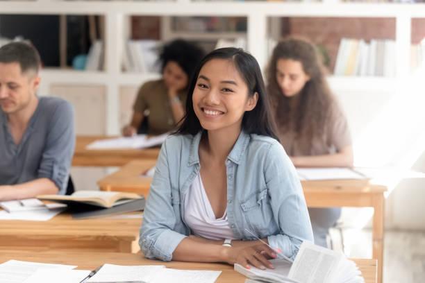 Smiling smart asian student looking at camera sitting at desk picture id1139791103?b=1&k=6&m=1139791103&s=612x612&w=0&h=95rkgmxsr8ixh4fr0kulm7osuprsj1prrr4xsiivcgw=