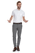 istock smiling smart casual man inviting with hands gesture 1131988853