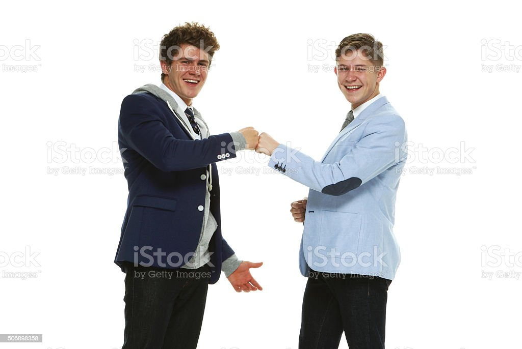 Smiling smart casual men doing fist bump stock photo more pictures smiling smart casual men doing fist bump royalty free stock photo m4hsunfo