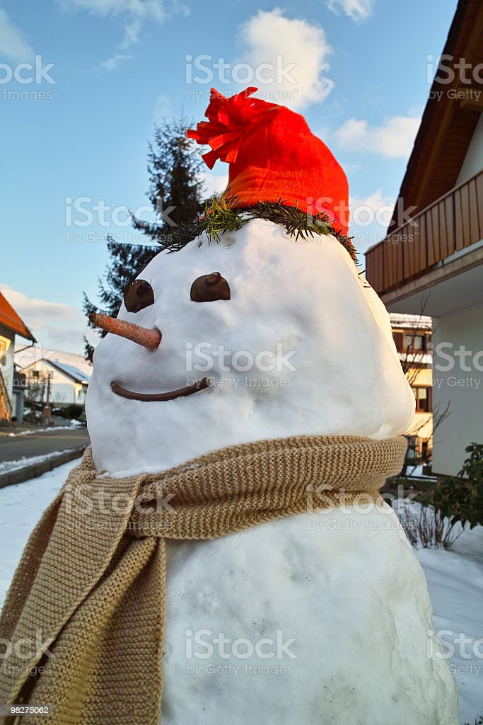 smiling snowman with red hut royalty-free stock photo