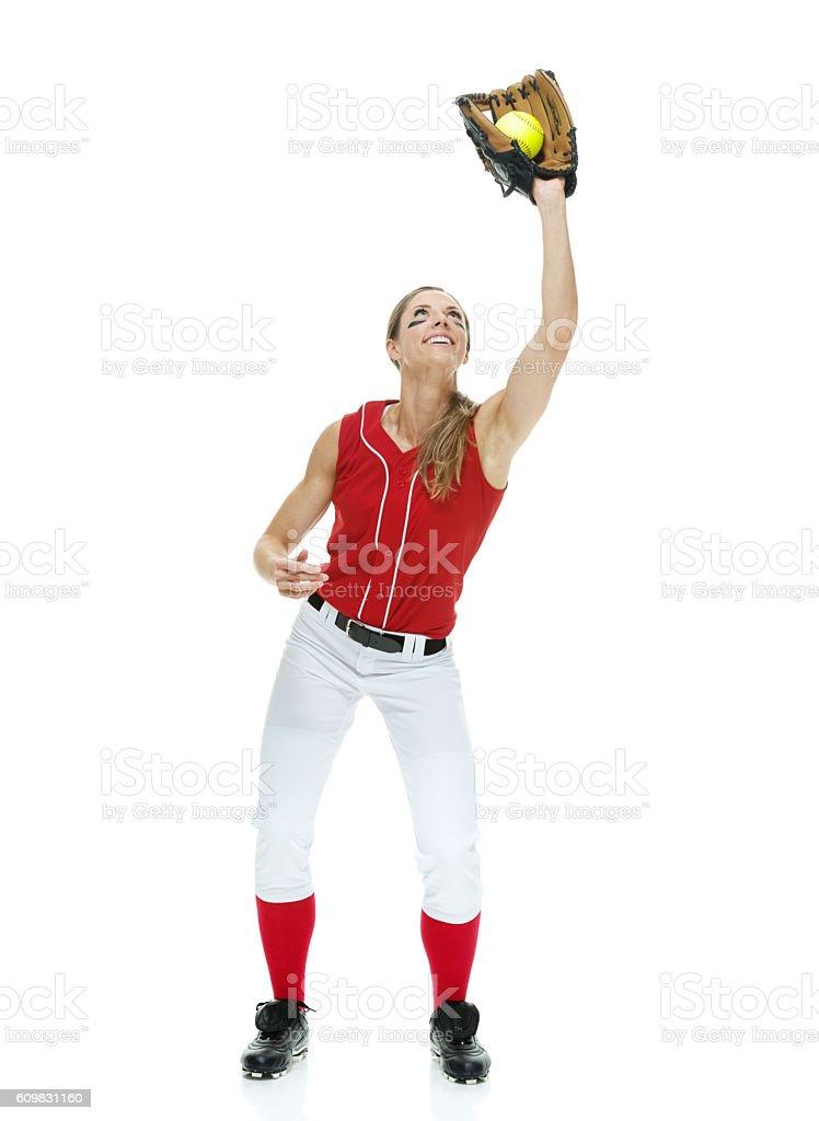 Smiling softball player catching stock photo
