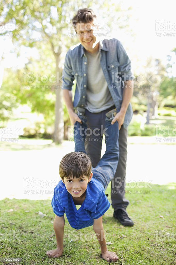 Smiling son and dad as they play together stock photo