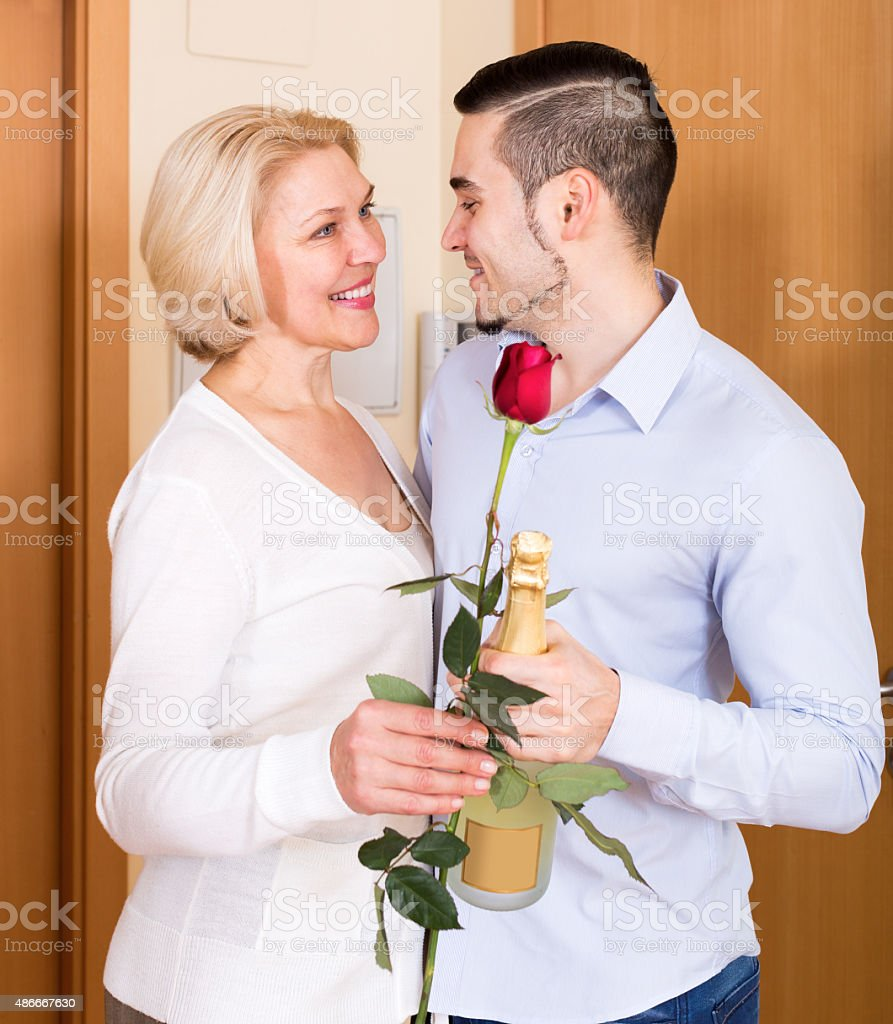 Smiling son and senior mother stock photo