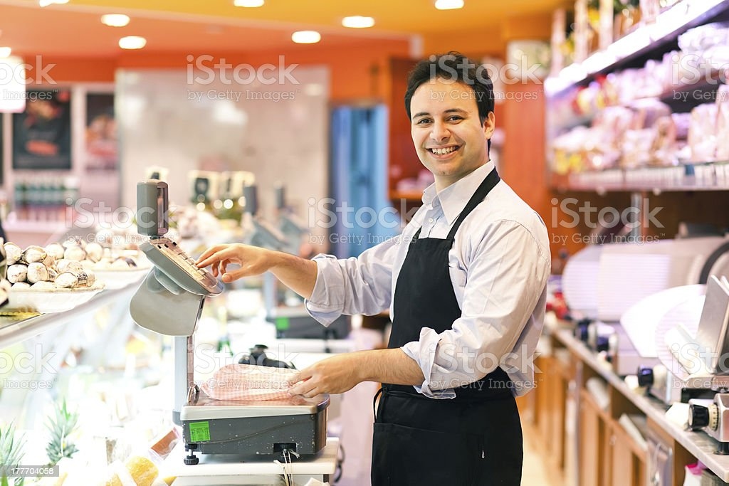 Smiling store keeper in his supermarket royalty-free stock photo