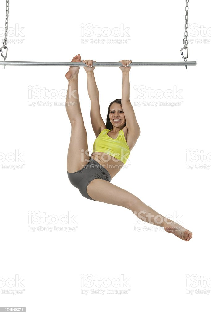 Smiling striptease dancer hanging on a pole stock photo