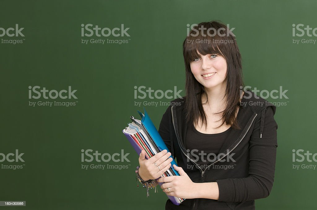 smiling student at blackboard royalty-free stock photo