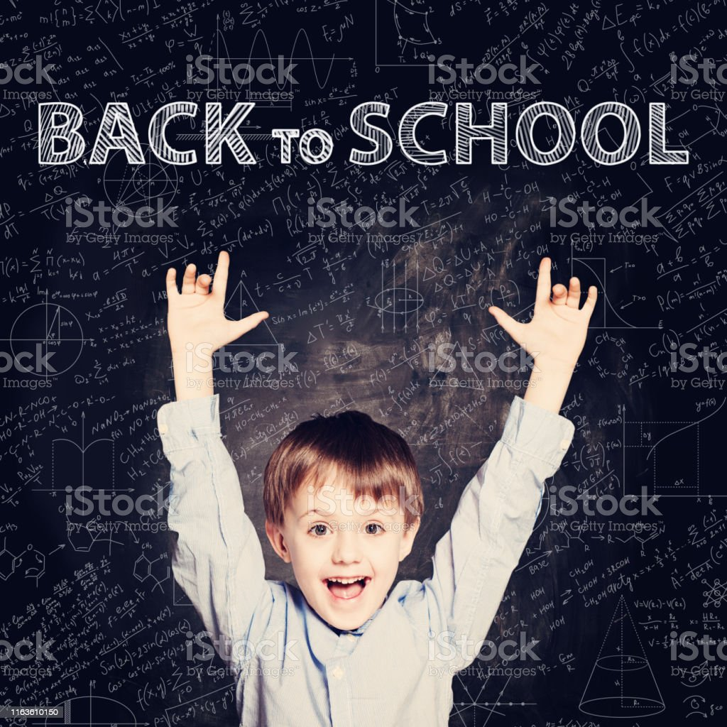 Smiling Student child thinking on chalkboard. Back to school...