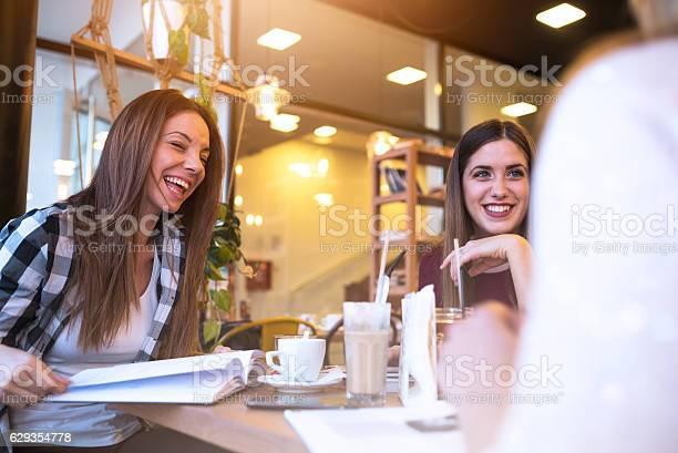 Smiling student girls talking in coffee shop after classes picture id629354778?b=1&k=6&m=629354778&s=612x612&h=estgbzqgrhziysfvzlvqegyhdz3plm95sy3uog 1rmo=