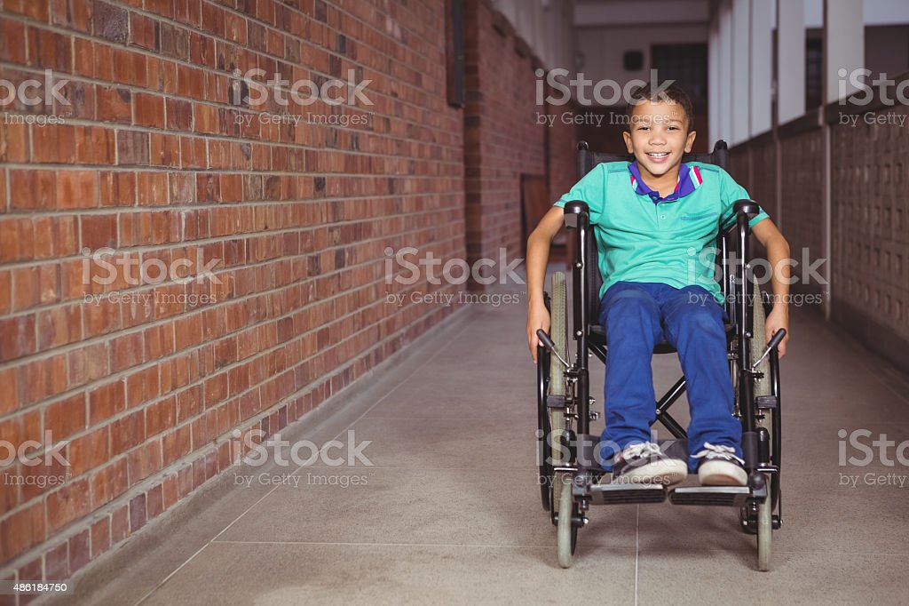 Smiling student in a wheelchair stock photo