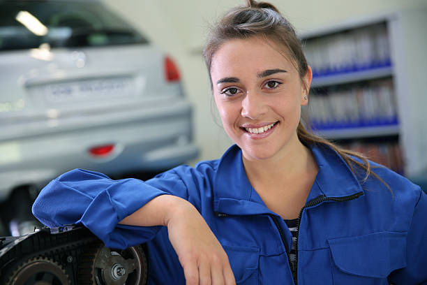Smiling student in garage stock photo