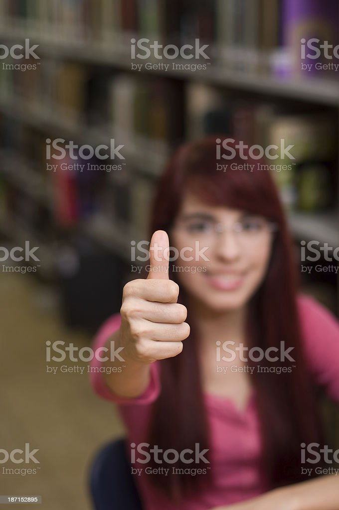 Smiling student in the library royalty-free stock photo