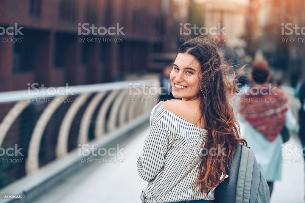 Smiling student looking back stock photo