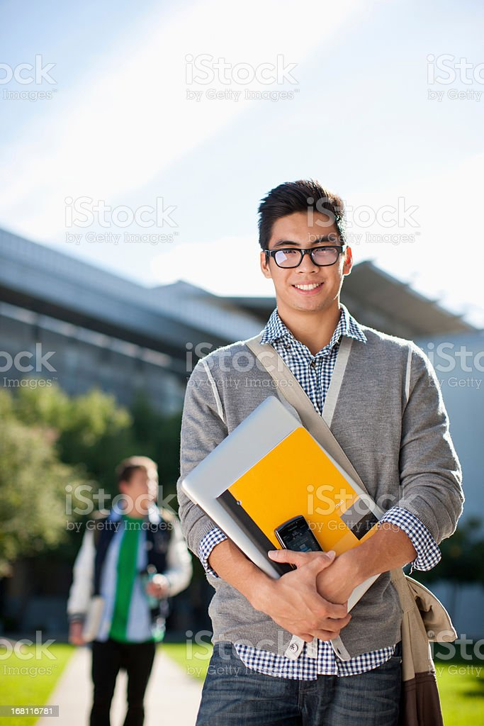 Smiling students standing outdoors royalty-free stock photo