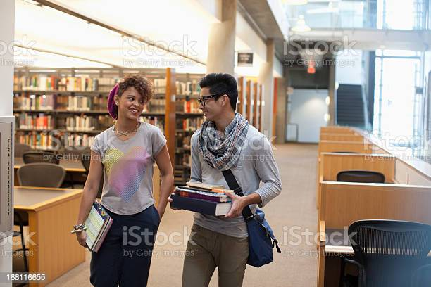 Smiling students talking in library picture id168116655?b=1&k=6&m=168116655&s=612x612&h=jailxpu8r0oswzxuipcrh1un7jrmfpu8swsk5hrcypa=