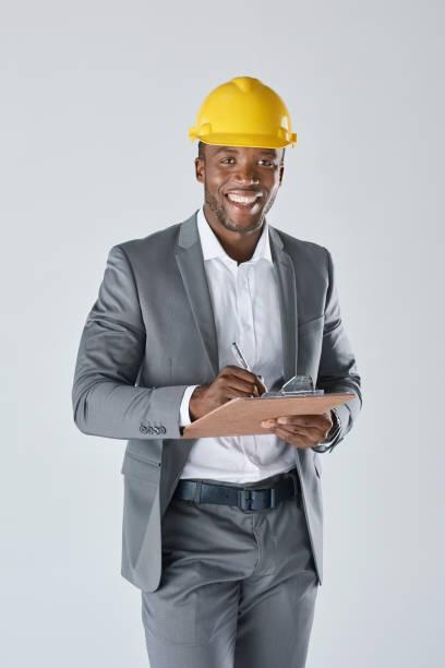 Smiling studio portrait of confident black engineer stock photo