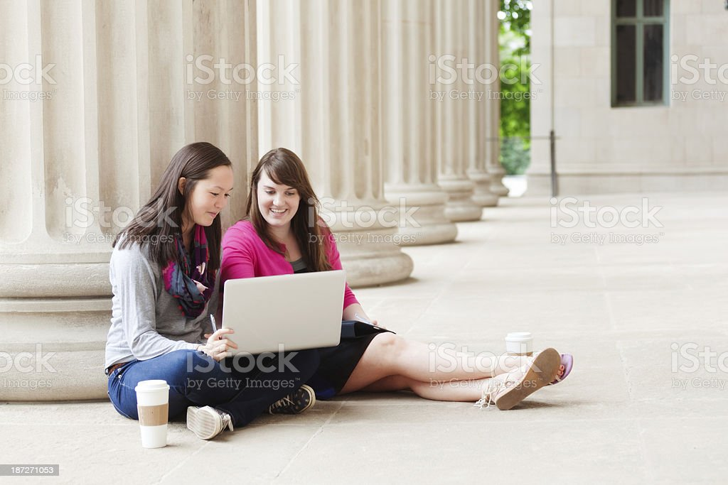 Smiling Studying Students with Laptop Computer on School Campus Horizontal stock photo