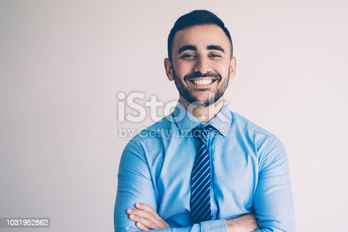 istock Smiling Successful Young Leader with Arms Crossed 1031952862