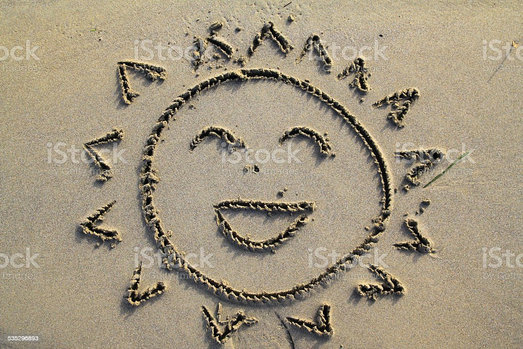 smiling sun in the beach stock photo