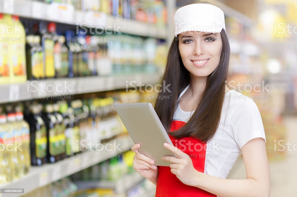 Smiling Supermarket Employee Holding a Pc Tablet stock photo