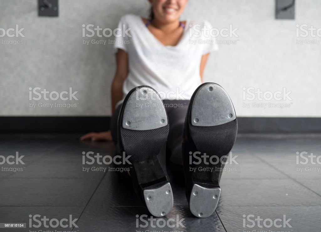 reasonable price authentic quality how to buy Smiling Tap Dancer Sitting On The Dance Studio Floor In Her Tap ...