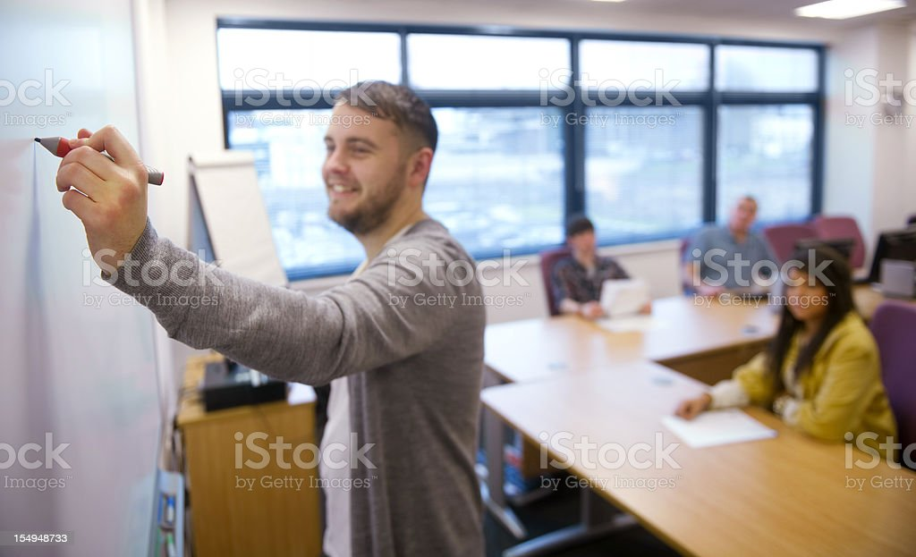 Smiling teacher and his class royalty-free stock photo