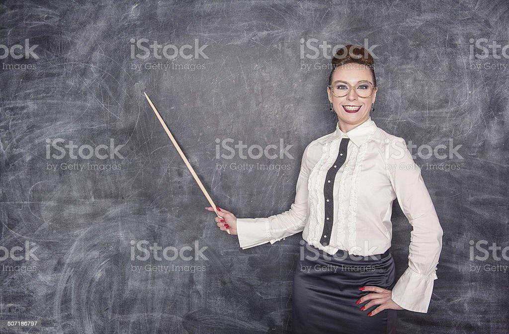 Smiling teacher with pointer stock photo