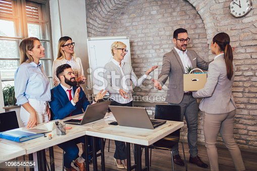 924520144 istock photo Smiling team leader executive introducing new just hired female employee to colleagues. 1096545254