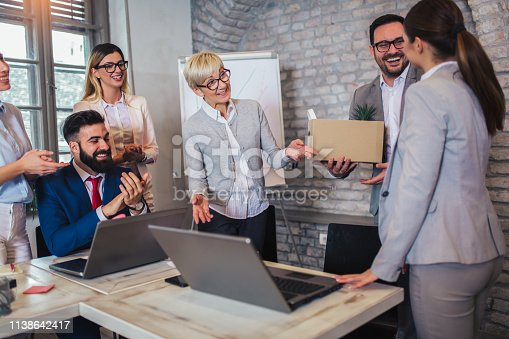 924520144 istock photo Smiling team leader executive introducing new just hired female employee to colleagues. 1138642417