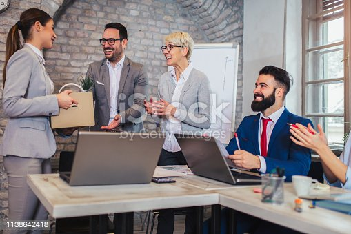 924520144 istock photo Smiling team leader executive introducing new just hired female employee to colleagues. 1138642418