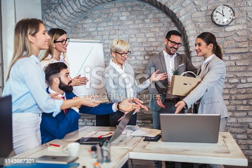 924520144 istock photo Smiling team leader executive introducing new just hired female employee to colleagues. 1143667321