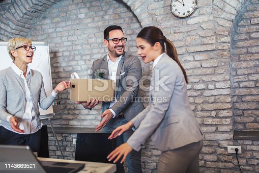924520144 istock photo Smiling team leader executive introducing new just hired female employee to colleagues. 1143669521