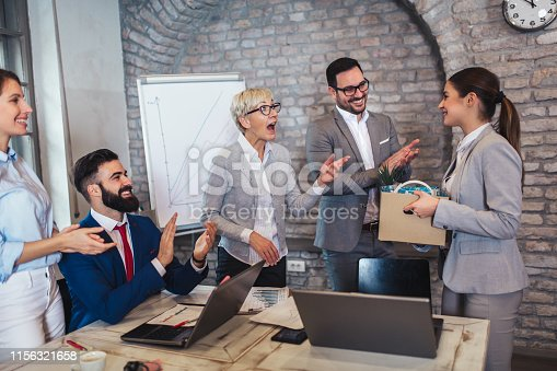924520144 istock photo Smiling team leader executive introducing new just hired female employee to colleagues. 1156321658