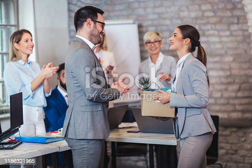 924520144 istock photo Smiling team leader executive introducing new just hired female employee to colleagues. 1156321965