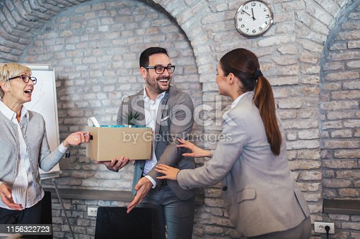 924520144 istock photo Smiling team leader executive introducing new just hired female employee to colleagues. 1156322723